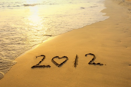 happy new year 2012 on the beach of sunrise photo
