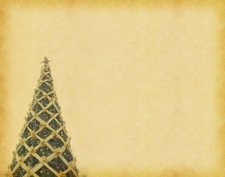 christmas tree on antique vintage paper background photo