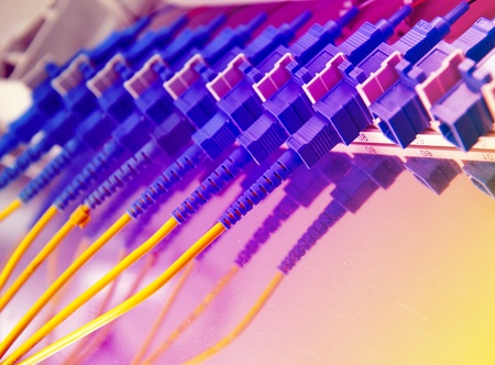 fiber cables and hub in data center  Stock Photo