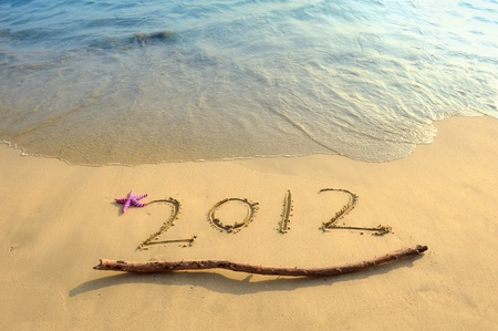 Numbers 2012 on tropical beach sand with starfish  photo