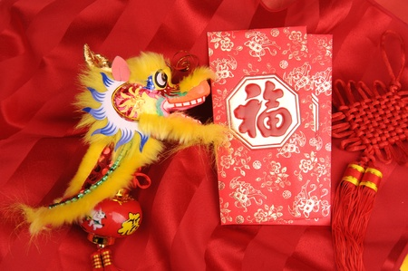Chinese New Year Ornaments--Traditional Dancing Dragon,golden coin and Money Red Packet,red firecracker  photo