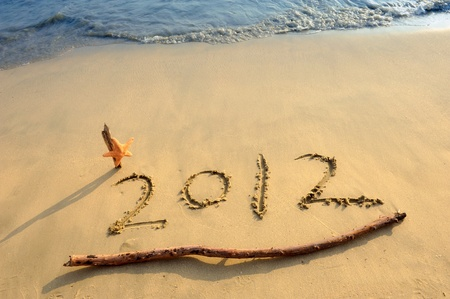 Numbers 2012 on tropical beach sand with starfish Stock Photo - 11931590