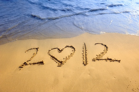 heart shape with happy new year 2012 on the beach of sunrise  photo