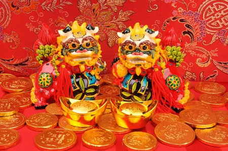 Chinese New Year Ornaments--Traditional Dancing lion,golden coin and Money photo