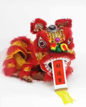 miniature people:             traditional dancing lion for lucky of Chinese New Year