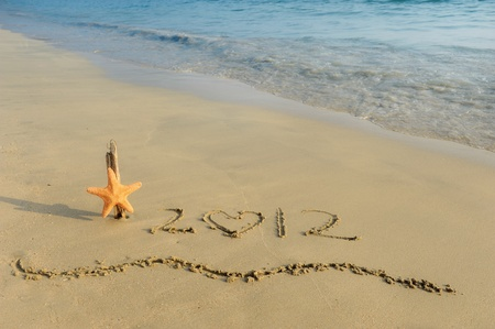 Numbers 2012 on tropical beach sand with starfish Stock Photo - 12048710