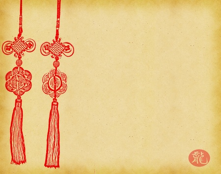 Chinese Knot on on Old antique vintage paper background  photo