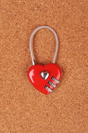 heart shape lock locked up with wood background   photo