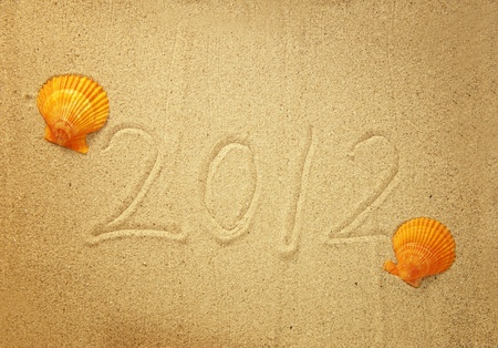 Numbers 2012 on tropical beach sand with shell  photo