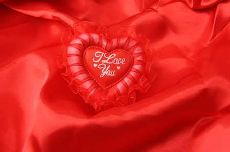 lace heart pillow on red silk photo