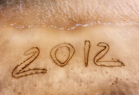 number 2012 on the beach of sunrise photo