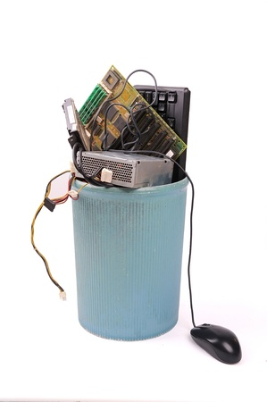 different computer parts and phone in trash can Stock Photo - 13602777