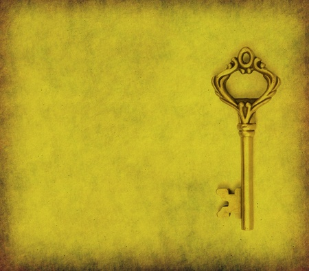 old key on the old textured paper with natural patterns Stock Photo - 13488049
