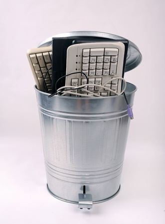 different computer parts in trash can photo