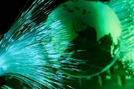 networking cables: computer data concept with earth globe against fiber optic background