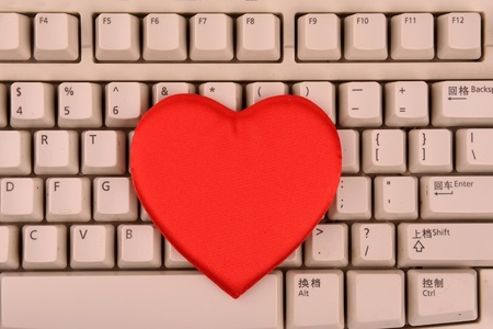 netbooks: Red heart on keyboard Stock Photo