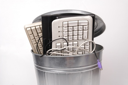 discarded metal: different computer parts and phone in trash can Stock Photo