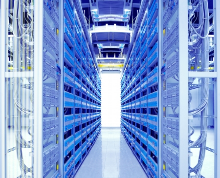 network cables: shot of network cables and servers in a technology data center