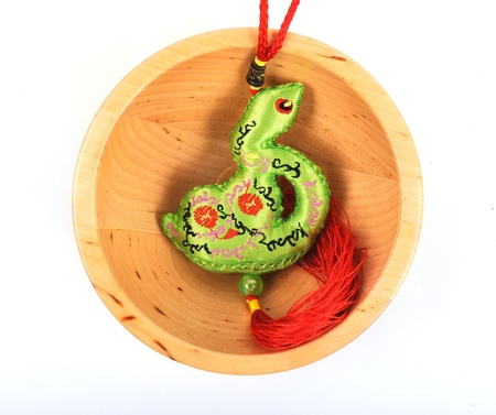 chinese snake in wood bowl mean good luck photo
