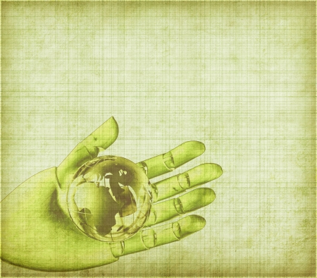 Global in wooden hand on Old antique vintage paper background photo