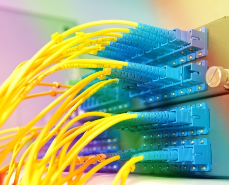 closeup of fiber optical network hub and cables photo