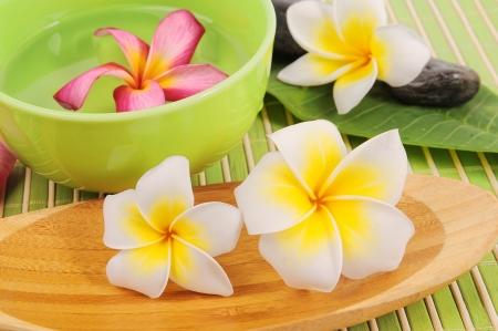 fragrant scents: Frangipani and polished stone on bamboo mat