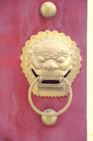 traditional chinese temple with guardian door knockers photo