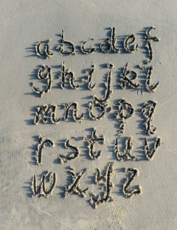 alphabet letters handwritten in sand on beach Stock Photo - 15225579
