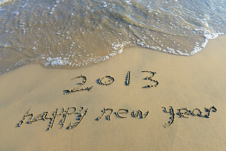 happy new year written in the sand Stock Photo - 15717182