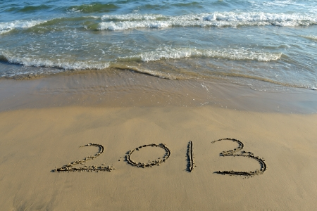 number 2013 on the beach of sunrise photo