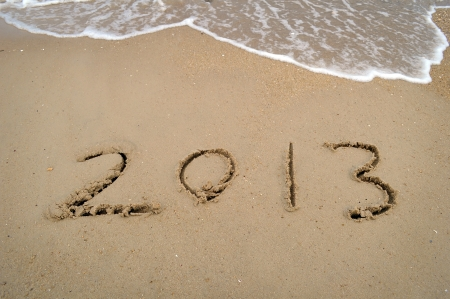 number 2013 on the beach of sunrise Stock Photo - 16215872