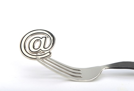 mail order: email symbol on a fork isolated on white background