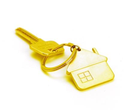 golden house key isolated on white Stock Photo - 16564442
