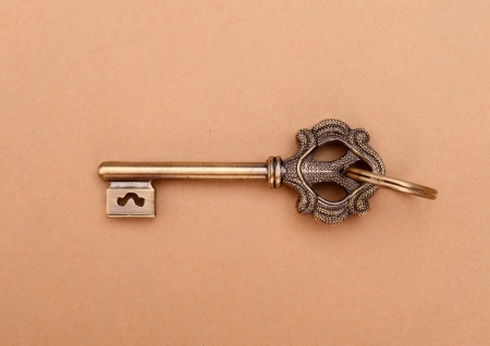 antique keys on wooden table photo