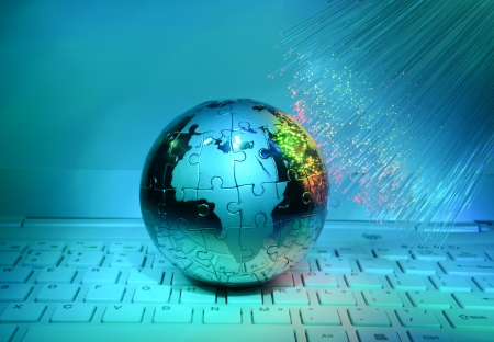 computer data concept with earth globe against fiber optic background photo
