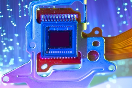close circuit camera: CCD sensor on a card of digital camera with fiber optical background