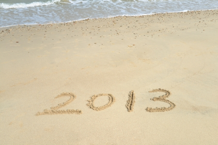 new year 2013 written in sand on beach photo