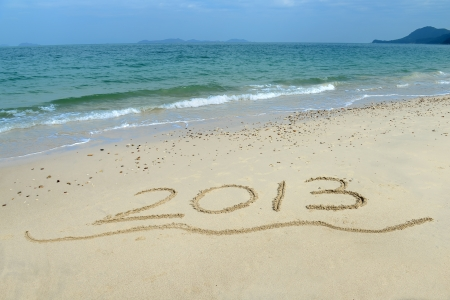 new year 2013 written in sand on beach Stock Photo - 16641940