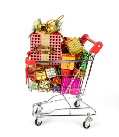 full filled: Shopping cart with Christmas gifts and presents  Stock Photo