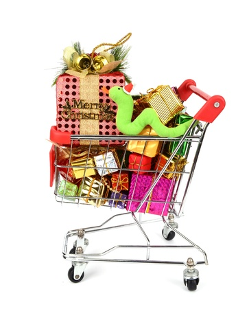 Shopping cart fill with Christmas Decorations background and Cute Christmas snake photo