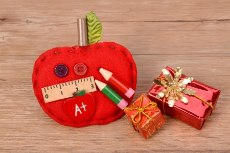 school ornaments  on wood background photo