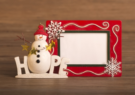 lonely snowman make of corrugated paper photo
