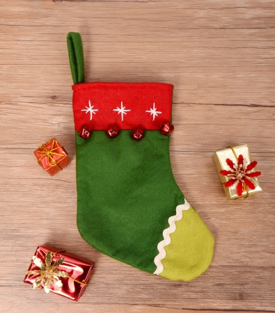 christmas sock: Christmas sock with gifts on wooden background Stock Photo