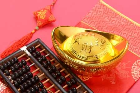 abaci: Chinese gold ingot and abacus mean symbols of wealth and prosperity