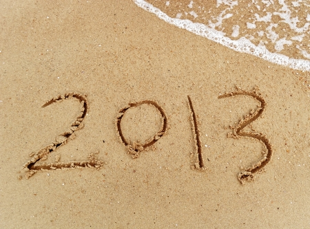 number 2013 on the beach of sunrise Stock Photo - 17057127