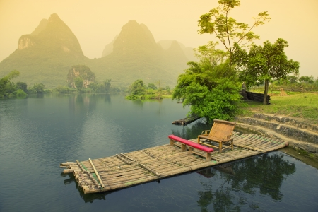Bamboo rafting on river, Yangshou, China photo