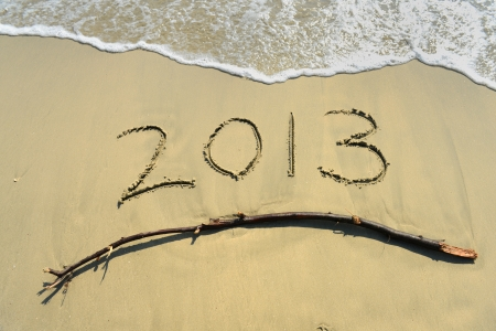 New year background with 2013 drawn in the sand photo
