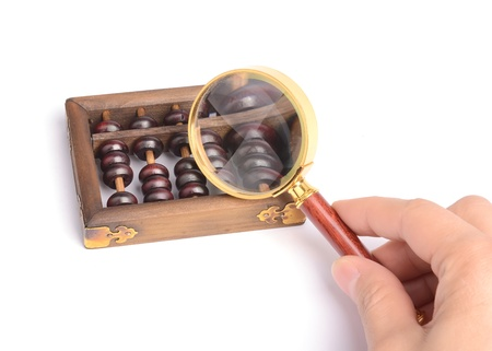 exaggerate: Chinese abacus and Magnifying glass,business concept Stock Photo