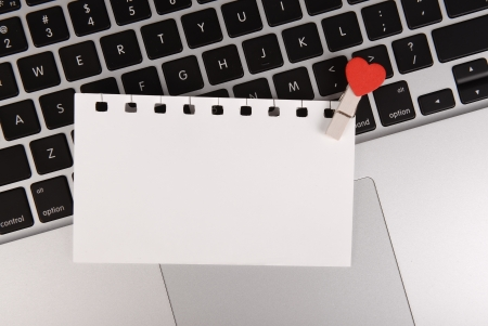 small red hearts and sticky note on Laptop keyboard Stock Photo - 17743889