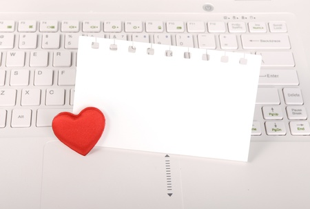 red hearts and sticky note on Laptop keyboard Stock Photo - 17743930